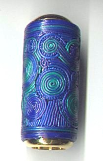 Miniature blue green filigree polymer clay kaleidoscope.