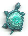 Polymer clay turtle pin.