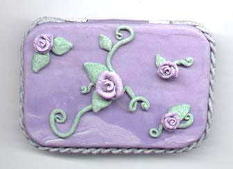 Polymer clay rose altoid tin.