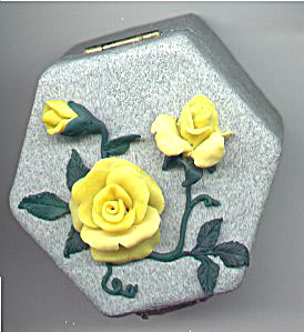 sculpted yellow roses on granitex